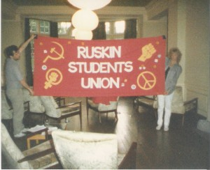1987, the RSU banner is being displayed in the Ruskin Hall students' lounge by Alex Pandolfo and Pat Hunter